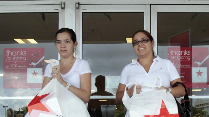 FILE - In this Sept, 29, 2011, file photo, Elsy Santiago, left, and her sister Betsy, exit a Macy's in Hialeah, Fla. Macy's Inc. is expected to report it's earnings Wednesday, May 9, 2012. (AP Photo/Alan Diaz, File)
