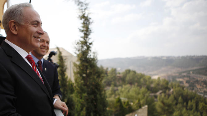 Israeli Prime Minister Benjamin Netanyahu looks at the area where Israel plans to build some 800 new housing units during his visit to the east Jerusalem Jewish neighborhood of Gilo, Tuesday, Oct. 23, 2012. Netanyahu vowed on Tuesday to continue building in a Jerusalem district days after European Union criticism because it is claimed by Palestinians.(AP Photo/Gali Tibbon, Pool)