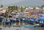 Fishing boats are anchored at the Vietnamese port of Nha Trang. Vietnamese authorities are investigating the mysterious deaths of two tourists from the United States and Canada who stayed in the same guesthouse, according to the Tuoi Tre newspaper