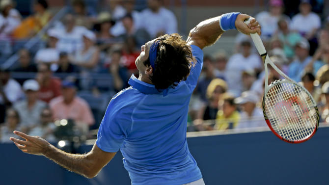 Roger Federer, of Switzerland, serves to Grega Zemlja, of Slovenia, during the first round of the 2013 U.S. Open tennis tournament Tuesday, Aug. 27, 2013, in New York. (AP Photo/Mike Groll)