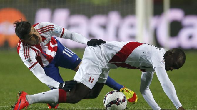 Paraguay's Benitez challenges Peru's Advincula during their Copa America 2015 third-place soccer match at Estadio Municipal Alcaldesa Ester Roa Rebolledo in Concepcion