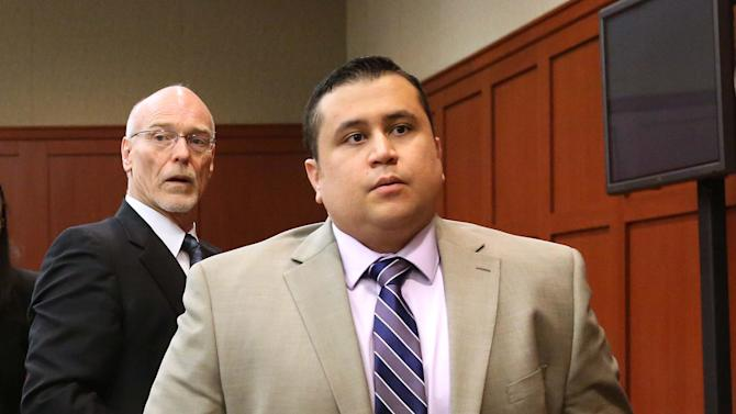 FILE - George Zimmerman, right, and attorney Don West, stand as the judge enters the courtroom in Seminole circuit court for a pretrial hearing, in Sanford, Fla., in this Saturday, June 8, 2013 file photo. Jury selection begins Monday June 10, 2013 in the second-degree murder trial, which is expected to last about six weeks. Martin's killing drew worldwide attention as it sparked a national debate about race, equal justice under the law and gun control.  (AP Photo/Orlando Sentinel, Joe Burbank, Pool)