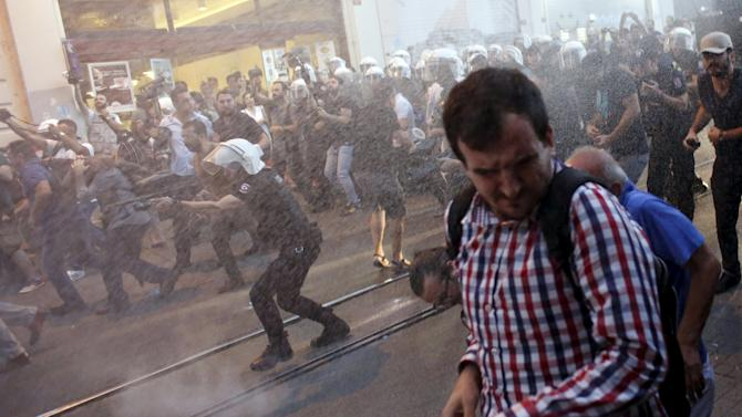 Riot police use water cannons and rubber pellets to disperse anti-government protesters during a peace day demonstration in central Istanbul, Turkey