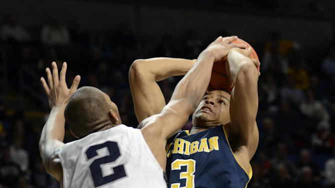 Michigan's Trey Burke (3) is fouled by Penn State's D.J Newbill (2) during the second half of an NCAA college basketball game in State College, Pa., Wednesday, Feb. 27, 2013. Penn State won 84-78. (AP Photo/Ralph Wilson)