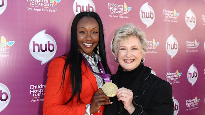 """IMAGE DISTRIBUTED FOR THE HUB - Carmelita Jeter, left, and Margaret Loesch, president and CEO of The Hub TV Network, attend The Hub TV Network's """"My Little Pony Friendship is Magic"""" Coronation Concert at the Brentwood Theatre on Saturday, Feb. 9, 2013, in Los Angeles in support of Children's Hospital LA. (Photo by Matt Sayles/Invision for The Hub/AP Images)"""