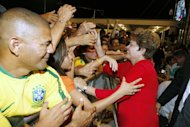 Brazilian President Dilma Rousseff greeting supporters at the Castelao stadium in Fortaleza on December 16, 2012. Dilma inaugurates the second stadium designated for 2014 World Cup matches