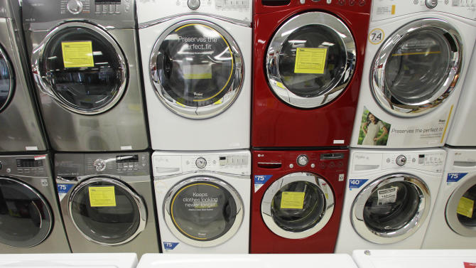 In this Wednesday, Sept. 18, 2013 photo, front-load washing machines are on display at a Sears store in Berlin, Vt. The Commerce Department reports on business orders for durable goods in August on Wednesday, Sept. 25, 2013. (AP Photo/Toby Talbot)