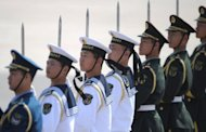A Chinese military honor guard line up before Russian President Vladimir Putin's arrival at Beijing International Airport. China and Russia has pledged to increase their cooperation in the United Nations, as the giant neighbours try to resist mounting pressure for international action to stop the bloodshed in Syria