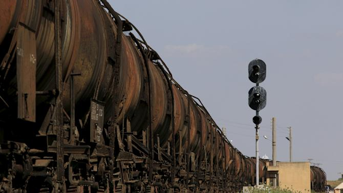 Abandoned train tank wagons are pictured in Kfar Halab train station in the western countryside of Aleppo