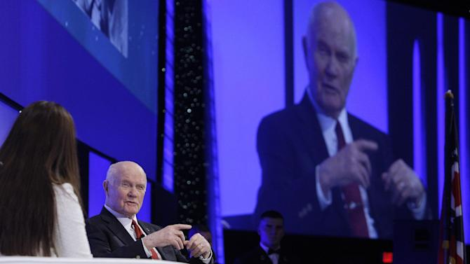 Sen. John Glenn answers questions during a celebration dinner honoring his legacy on the 50th anniversary of his historic flight aboard Friendship 7 Monday, Feb. 20, 2012, in Columbus, Ohio. Glenn was the first American to orbit Earth, piloting Friendship 7 around it three times in 1962, and also became the oldest person in space, at age 77, by orbiting Earth with six astronauts aboard shuttle Discovery in 1998. (AP Photo/Jay LaPrete)