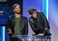 Dan Auerbach, left, and Patrick Carney accept the award for best rock album &quot;El Camino&quot; at the 55th annual Grammy Awards on Sunday, Feb. 10, 2013, in Los Angeles. (Photo by John Shearer/Invision/AP)