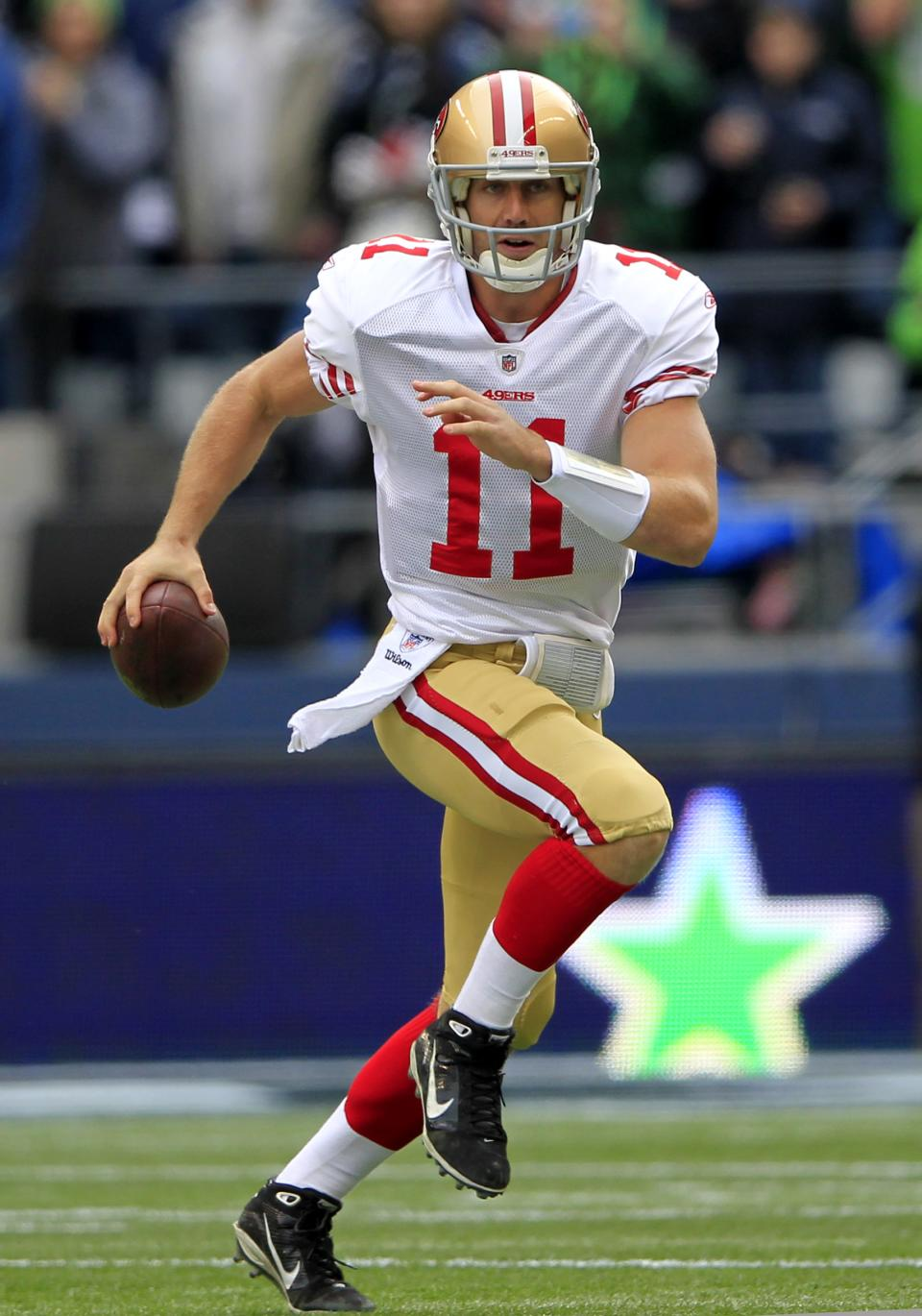 San Francisco 49ers'  Alex Smith scrambles against the Seattle Seahawks in the first half of an NFL football game Saturday, Dec. 24, 2011. (AP Photo/John Froschauer)