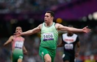 Ireland's Jason Smyth reacts as he crosses the finish line to win the Men's 100 metres T13 athletics final during the London 2012 Paralympic Games. Smyth retained his T13 100m title, breaking his own world record in the process to become the fastest Paralympian in history