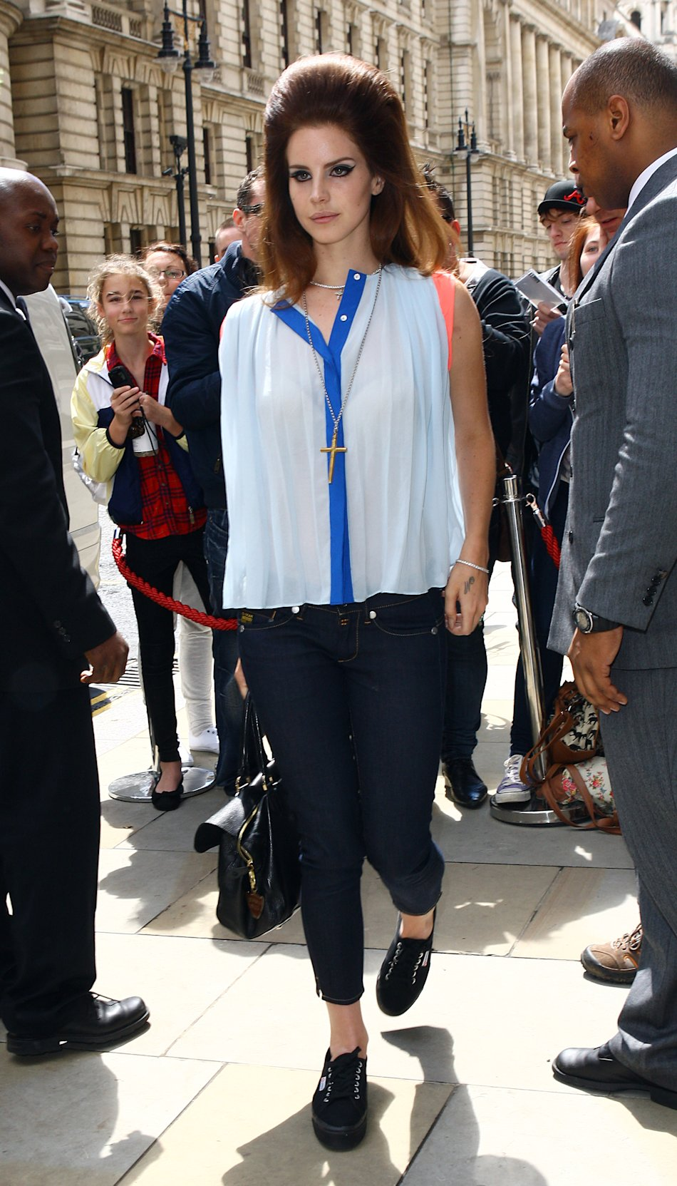Here's Lana del Rey in London on June 24 with a serious clothes departure from her usual glammed-up ensembles, save for her big hair and dramatic make-up, thank goodness. Her neon-accented Sandro top,