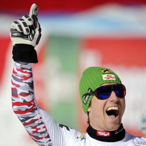 Austrian Marcel Hirscher reacts in the finish area of the alpine ski, men's World Cup super-G race, in Schladming, Austria, Thursday, March 15, 2012. (AP Photo/Keystone, Jean-Christophe Bott)