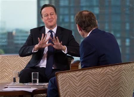 Britain's Prime Minister David Cameron speaks as he appears on the BBC's Andrew Marr Show, on the first day of the of the Conservative Party annual conference in Manchester