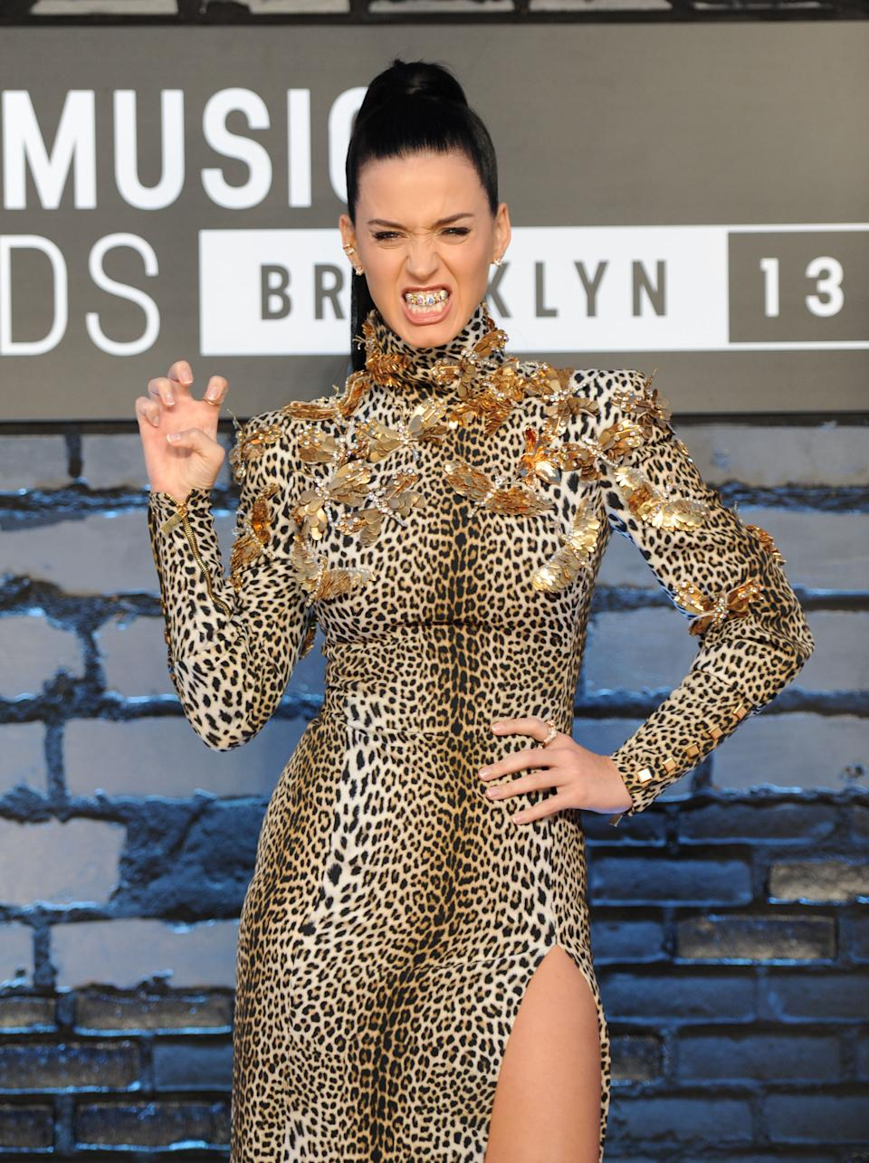 "Katy Perry wears a grill that says ""ROAR"" as she poses at the MTV Video Music Awards on Sunday, Aug. 25, 2013, at the Barclays Center in the Brooklyn borough of New York. (Photo by Evan Agostini/Invision/AP)"