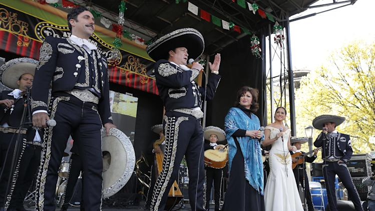 "IMAGE DISTRIBUTED FOR UNIVISION - From left, Rafael Negrete, Arturo Peniche, Angelica Maria, Danna Garcia, and Jorge Salinas, members of the hit primetime novela, ""Que Bonito Amor"" (What a Beautiful Love), perform for an audience of more than 100,000 fans in Flushing Meadows Park to celebrate Cinco de Mayo, Sunday, May 5, 2013, in the Queens borough of New York. Univision Network treated the adoring audience with the Mariachi performance as part of the Casa Puebla New York's festivities. (John Minchillo / AP Images for Univision)"