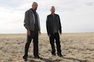 "FILE - This file image released by AMC shows Bryan Cranston as Walter White, left, and Aaron Paul as Jesse Pinkman in a scene from the season 5 premiere of ""Breaking Bad."" As ""Breaking Bad"" finishes filming its fifth and final season in Albuquerque, the popularity of the show is providing a boost to the economy and creating a dilemma for local tourism officials as they walk the fine line of profiting from a show that centers around drug trafficking, addiction and violence. (AP Photo/AMC, Ursula Coyote)"