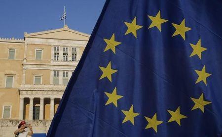 The European Union flag is seen in front of the parliament building during a Pro-Euro rally in Athens