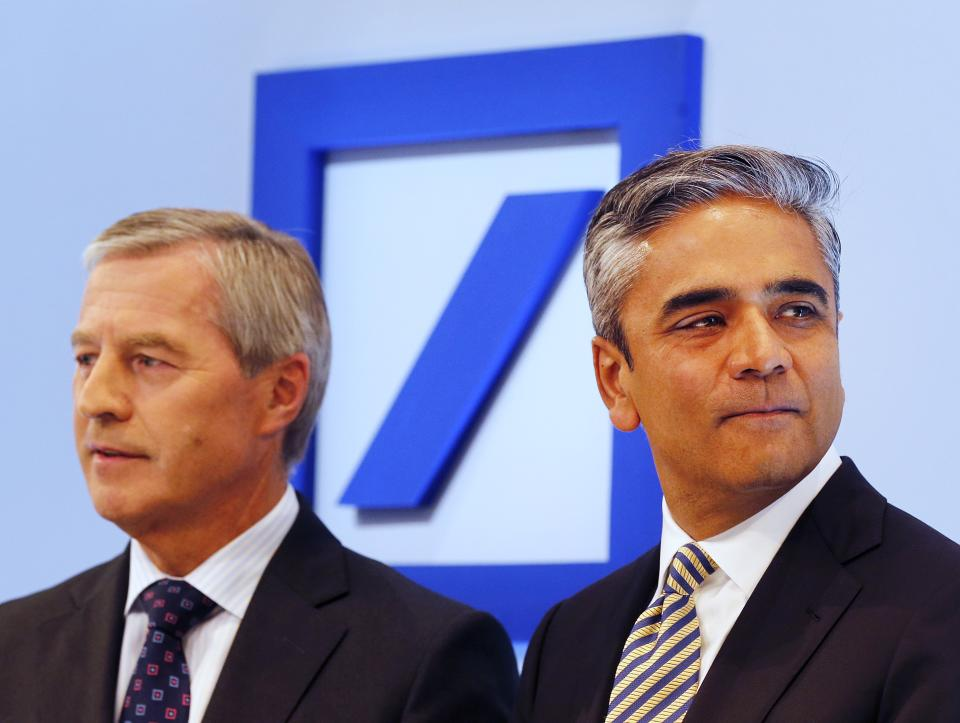 Deutsche Bank to cut costs, change pay practices