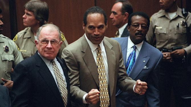 FILE - This Oct. 3, 1995 file photo shows O.J. Simpson, center, with defense attorneys F. Lee Bailey, left, and Johnnie Cochran after Simpson was found not guilty of murdering his ex-wife Nicole Brown Simpson and her friend Ron Goldman at the Criminal Courts Building in Los Angeles. Sony Electronics and the Nielsen television research company collaborated on a survey ranking TV's most memorable moments. Other TV events include, the Sept. 11 attacks in 2001, Hurricane Katrina in 2005, the Challenger space shuttle explosion in 1986 and the death of Osama bin Laden in 2011. (AP Photo/Myung J. Chun, file)