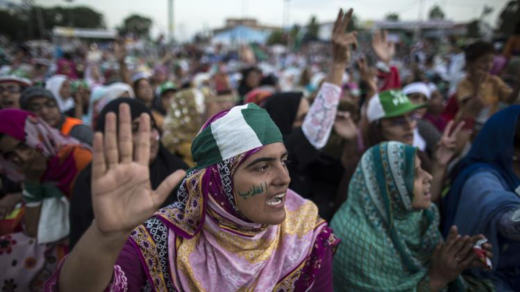 A supporter of ul-Qadri reacts as she listens to her leader's speech in Islamabad