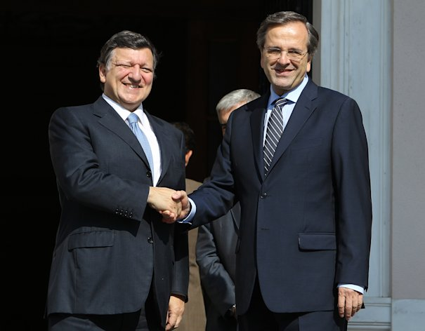 Greece's Prime Minister Antonis Samaras, right, and European Commission President Jose Manuel Barroso shake hands before their meeting at Maximos mansion in Athens, Thursday, July 26, 2012. International debt inspectors started new talks Thursday with the Greek government that will determine whether the country keeps receiving vital rescue loans or is forced to default and potentially leave the common European currency union. (AP Photo/Thanassis Stavrakis)