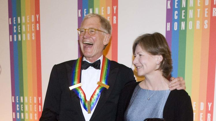 2012 Kennedy Center Honoree David Letterman, and his wife, Regina, arrive at the Kennedy Center for the Performing Arts for the 2012 Kennedy Center Honors Performance and Gala Sunday, Dec. 2, 2012 at the State Department in Washington. (AP Photo/Kevin Wolf)