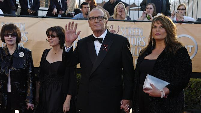 """James Garner, who will accept the 41st annual life achievement award, arrives with his family including his wife Lois Clarke, far left, for the 11th annual Screen Actors Guild Awards in this Saturday, Feb. 5, 2005 file photo taken in Los Angeles. Actor James Garner, wisecracking star of TV's """"Maverick"""" who went on to a long career on both small and big screen, died Saturday July 19, 2014 according to Los angeles police. He was 86. (AP Photo/Chris Pizzello, File)"""