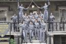 FILE- This undated file image obtained from Twitter on Saturday, May 7, 2016 shows 16 black, female cadets in uniform with their fists raised while posing for a photograph at the United States Military Academy at West Point, N.Y. The U.S. Military Academy said Tuesday, May 10, that it concluded the group photo didn't violate any Department of Defense rules limiting political activity. (Obtained from Twitter via AP, FIle)