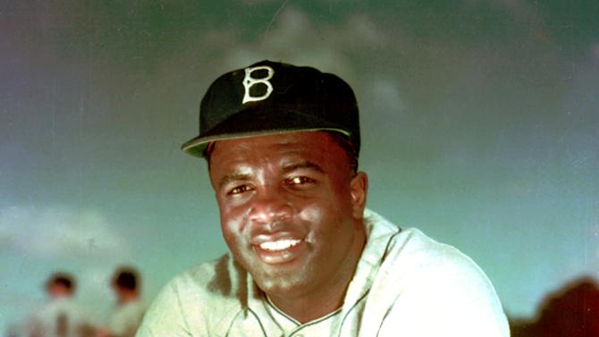 """FILE - Brooklyn Dodgers baseball player Jackie Robinson poses in 1952. Kansas City's Negro Leagues Baseball Museum is hosting an advance screening of an upcoming movie about Robinson, who broke major league baseball's color barrier. Thomas Butch of the financial firm Waddell and Reed announced Wednesday, March 20, 2013 that actors Harrison Ford and Andre Holland will be among those appearing at an April 11 screening of """"42.""""   (AP Photo/File)"""