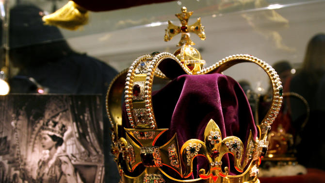 FILE This Friday March 9, 2012 file photo shows a replica of the Coronation Crown, part of the Crown Jewels, displayed at Sotheby's auction house in London made around the time of Queen Elizabeth's Coronation in order to travel and to be shown to the Commonwealth countries. A rare security breach has been reported at the Tower of London, one of the British capital's most famous landmarks. Authorities say the Crown Jewels and other unique artifacts are safe but that locks had to be changed after an intruder broke in and stole some keys.  Officials said Monday Nov. 12, 2012 the keys were stolen from a sentry box at the site. (AP Photo/Brynjar Gauti)