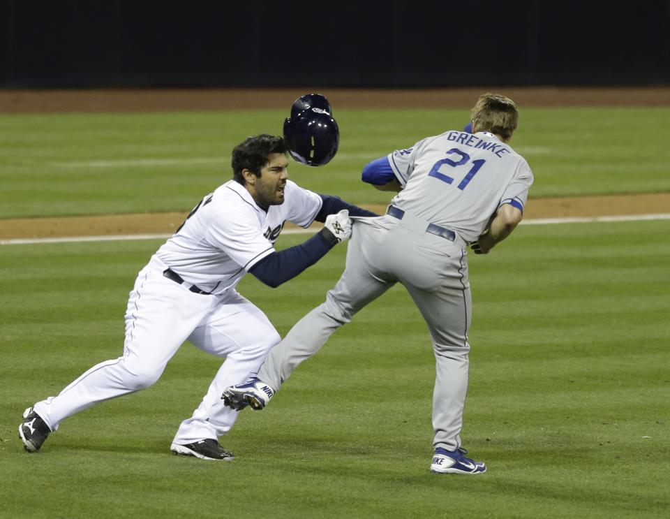 San Diego Padres' Carlos Quentin charges into Los Angeles Dodgers  pitcher Zack Greinke after being hit by a pitch in the sixth inning of baseball game in San Diego, Thursday, April 11, 2013. (AP Photo/Lenny Ignelzi)