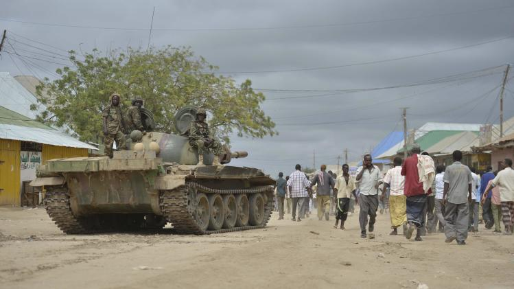 Residents walk along a street in Bulamareer, in the Lower Shabelle region of Somalia