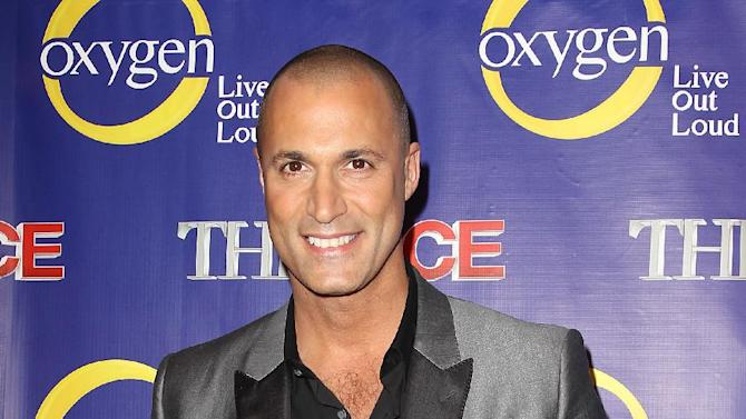 """This Feb. 5, 2013 photo released by Starpix shows photographer Nigel Barker at the premiere of the Oxygen network series, """"The Face,"""" in New York. Naomi Campbell, along with models Coco Rocha and Karolina Kurkova, are coaches to aspiring models in a competition to find the next face of beauty retailer ULTA Beauty. The show, hosted by fashion photographer Nigel Barker, premieres on Feb. 12 at 9 p.m. EST on Oxygen.  (AP Photo/Starpix,  Kristina Bumphrey)"""