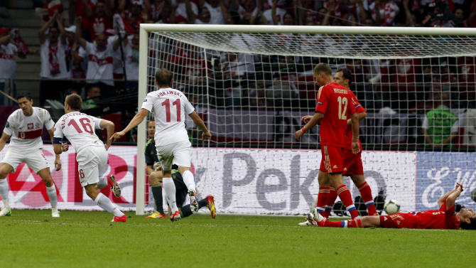 Poland's Jakub Blaszczykowski, second left, celebrates after scoring a goal  during the Euro 2012 soccer championship Group A match between Poland and Russia in Warsaw, Poland, Tuesday, June 12, 2012. (AP Photo/Michael Sohn)