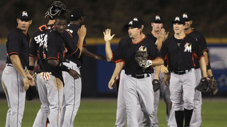 The Miami Marlins celebrates defeating the New York Yankees in Legend Series at the Rod Carew Stadium in Panama City
