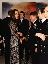 The Duchess of Cambridge talks with guests and dignitaries as she arrives for the UK Premiere of 'War Horse' in aid of The Foundation of Prince William and Prince Harry, at a central London cinema, London, Sunday, Jan. 8, 2012. (AP Photo/Ian Gavan, Pool)