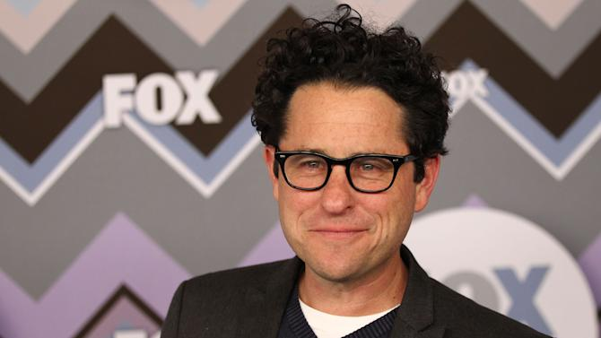"""FILE - In this Jan. 8, 2013 file photo, J.J. Abrams arrives at the Winter TCA Fox All-Star Party at the Langham Huntington Hotel in Pasadena, Calif. Abrams is set to direct the next installment of """"Star Wars,"""" which Disney has said will be """"Episode 7"""" and due out in 2015. Disney bought """"Star Wars"""" maker Lucasfilm last month for $4.06 billion.  (Photo by Matt Sayles/Invision/AP, File)"""