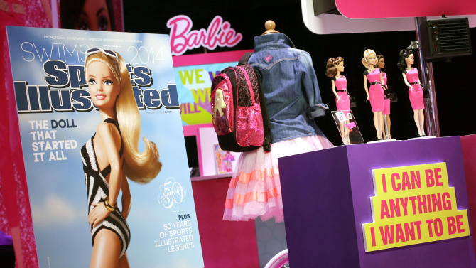 FILE - In this Friday, Feb. 14, 2014 file photo, a mock-up cover of Barbie on a Sports Illustrated swimsuit issue is displayed at the Mattel booth at the American International Toy Fair in New York. A few weeks after her foray into the Sports Illustrated swimsuit edition, Barbie is entangled in controversy again, this time over her ties with the Girl Scouts. Two advocacy groups often critical of corporate advertising tactics _ the Campaign for a Commercial-Free Childhood and the Center for a New American Dream _ on Thursday, March 6, 2014 urged the Girl Scouts of USA to end its partnership with the doll's manufacturer, the Mattel toy company. (AP Photo/Mark Lennihan)