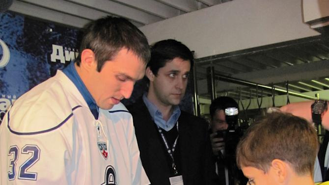 Alex Ovechkin signs photo for a fan
