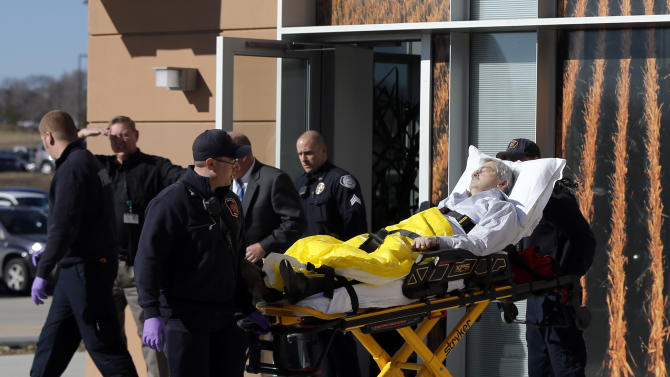 Iowa Gov. Terry Branstad is taken to a hospital after he fell ill at an event Monday, Jan. 26, 2015, in Johnston, Iowa. Branstad's  spokesman said he was conscious during the ambulance ride and that the governor has been fighting a cold. (AP Photo/The Register, Zach Boyden-Holmes) MANDATORY CREDIT