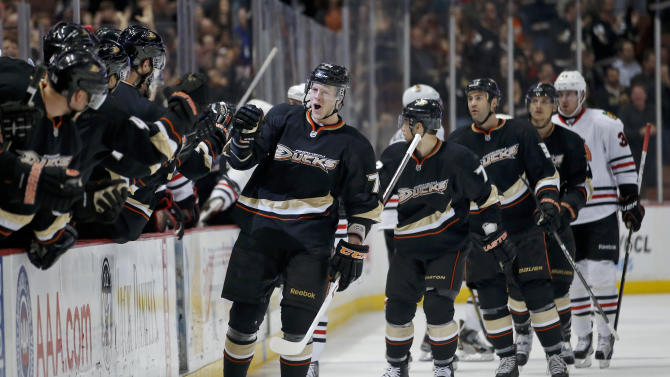 Anaheim Ducks' Peter Holland, center, celebrates his goal against the Chicago Blackhawks during the first period of an NHL hockey game in Anaheim, Calif., Wednesday, March 20, 2013. (AP Photo/Jae C. Hong)