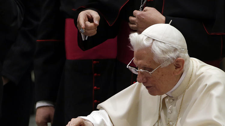 "Pope Benedict XVI pushes a button on a tablet at the Vatican, Wednesday, Dec. 12, 2012. Pope Benedict XVI hit the 1 million Twitter follower mark on Wednesday as he sent his first tweet from his new account, blessing his online fans and urging them to listen to Christ. In perhaps the most drawn out Twitter launch ever, the 85-year-old Benedict pushed the button on a tablet brought to him at the end of his general audience after the equivalent of a papal drum roll by an announcer who intoned: ""And now the pope will tweet!"" ""Dear friends, I am pleased to get in touch with you through Twitter. Thank you for your generous response. I bless all of you from my heart,"" the inaugural tweet read. (AP Photo/Gregorio Borgia)"