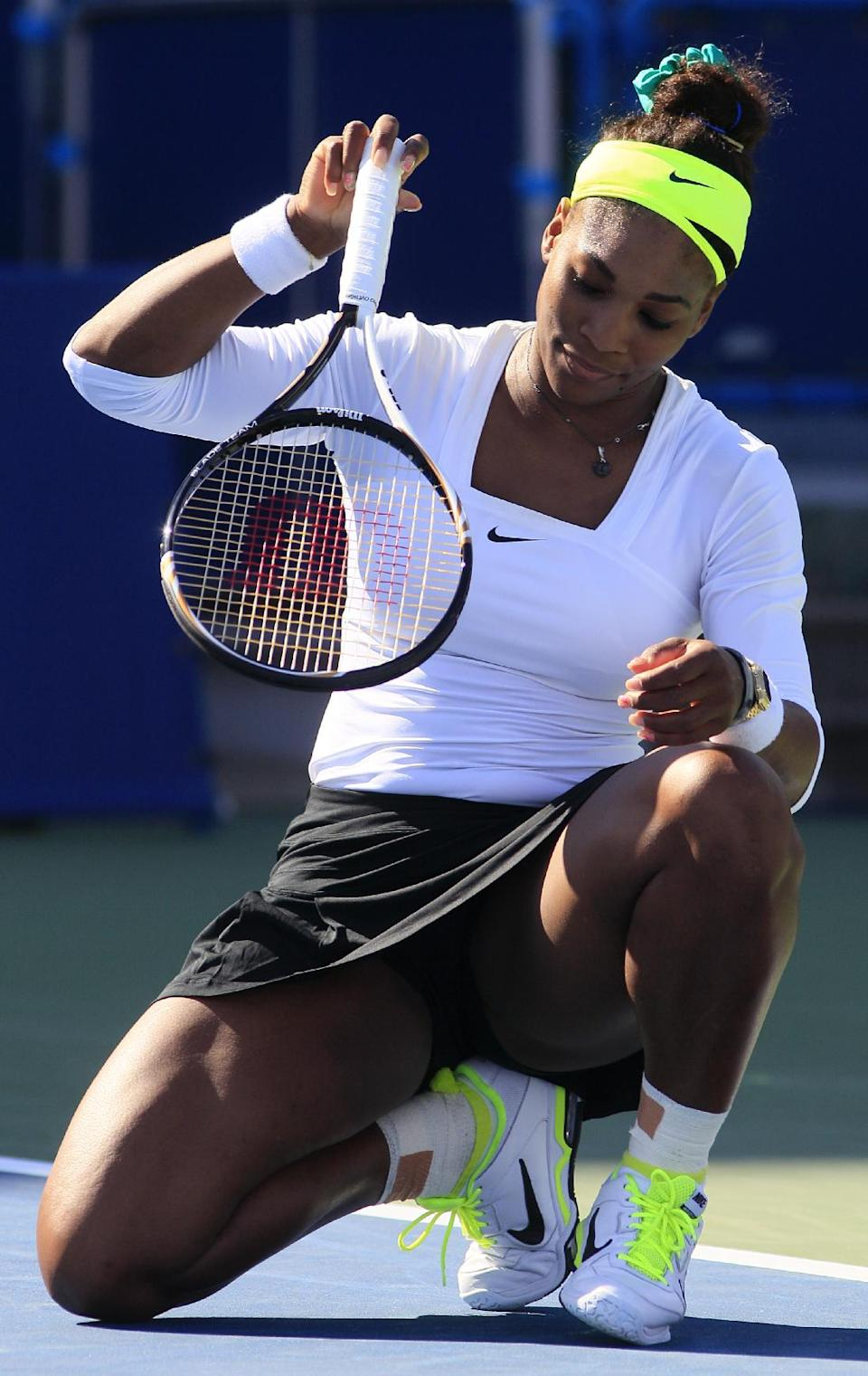 Serena Williams reacts after missing a point against Angelique Kerber, from Germany, during a quarterfinal at the Western & Southern Open tennis tournament, Friday, Aug. 17, 2012, in Mason, Ohio. Kerber won 6-4, 6-4. (AP Photo/Al Behrman)