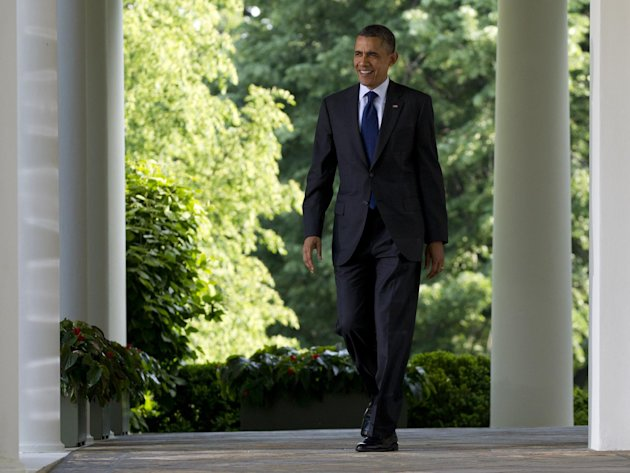 FILE - In this May 3, 2012, file photo, President Barack Obama walks from the Oval Office as he arrives to speak at a celebration of Cinco de Mayo in the Rose Garden of the White House in Washington. Despite a relentless workload ahead, President Barack Obama is lighter on his feet in one sense as he opens his second term. Gone are the hundreds of promises of the past. He's toting carry-ons instead of heavy cargo this time. Failing to achieve a promised first-term overhaul of immigration law, Obama took stopgap executive action to help as many as 1.7 million younger illegal immigrants stay in the country, and now, after an election marked by Hispanic clout, finds the political landscape more amenable to trying again. (AP Photo/Carolyn Kaster, File)