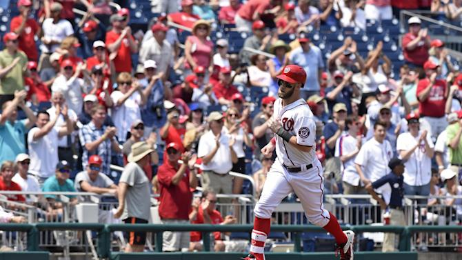 Washington Nationals right fielder Bryce Harper (34) rounds third base after hitting a home run against the Miami Marlins during the second inning of a baseball game at Nationals Park in Washington, Wednesday, May 6, 2015. The Nationals beat the Marlins, 7-5. (AP Photo/Susan Walsh)