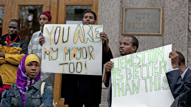 Protesters chant outside city hall in Lewiston, Maine, after delivering petitions asking for the resignation of the city's mayor because of comments he made about Somali refugees,Thursday, Oct. 4, 2012. (AP Photo/Robert F. Bukaty)