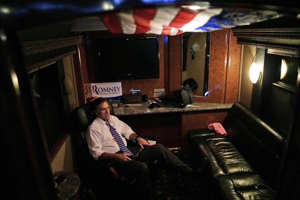 Republican presidential candidate and former Massachusetts Gov. Mitt Romney talks on his phone at the back of his bus after the last campaign rally of the day at the Veterans Memorial Coliseum, Marion County Fairgrounds, in Marion, Ohio, Sunday, Oct. 28, 2012. (AP Photo/Charles Dharapak)